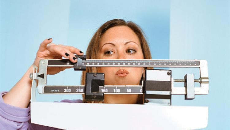 Weight loss in women can reduce the risk of having a serious type of breast cancer