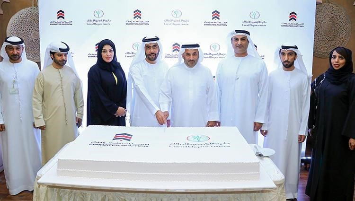شراكة بين أراضي دبي والإمارات للمزادات