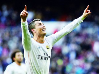 Real Madrids Portuguese forward Cristiano Ronaldo celebrates after scoring during the Spanish league football match Real Madrid vs FC Granada at the Santiago Bernabeu stadium in Madrid on January 25, 2014.  AFP PHOTO / DANI POZO